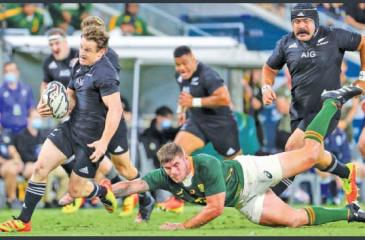 A South African player goes down missing his tackle