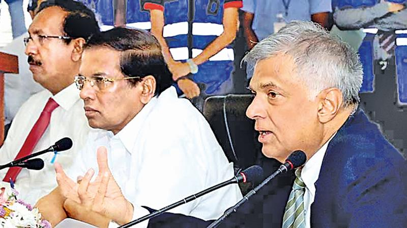 President Maithripala Sirisena and Prime Minister Ranil Wickremesinghe at a high level meeting to discuss on Meetotamulla issue in  Colombo last week.