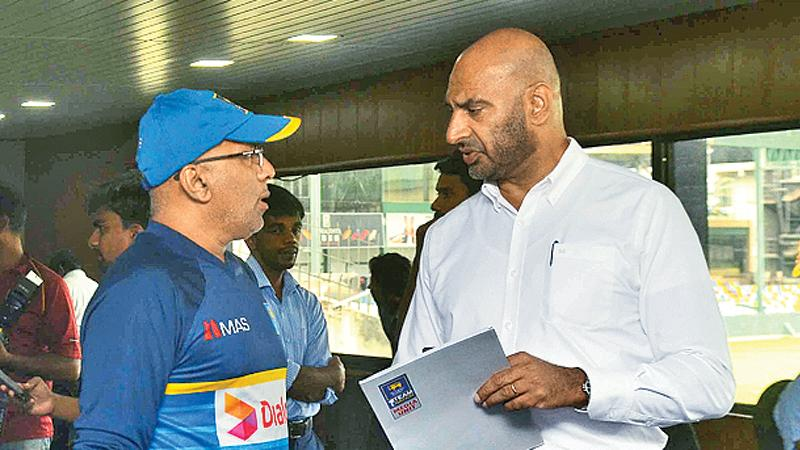 Chief selector Graeme Labrooy (right) drives a point into coach Chandika Hathurusinghe in the aftermath of drastic changes in the Sri Lanka team