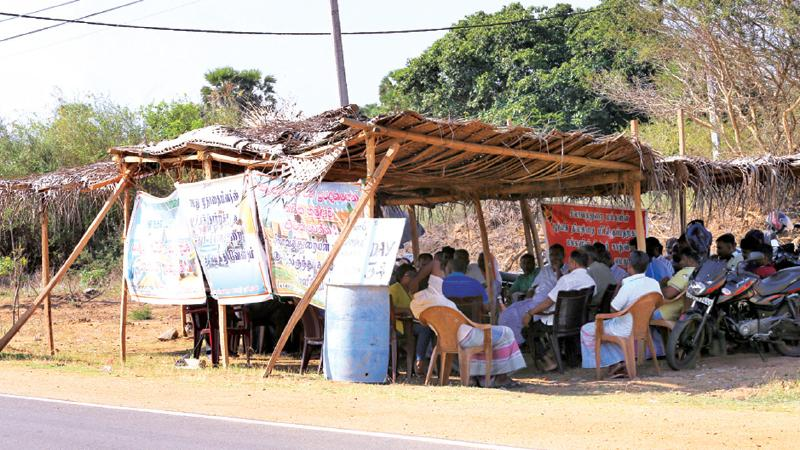 A sit-in protest in front of the Silavathurai Navy camp