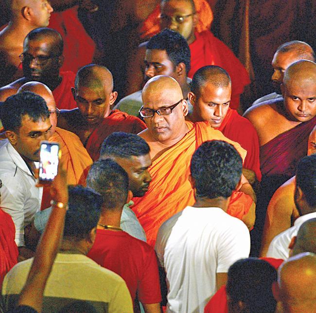 General Secretary of the Bodu Bala Sena (BBS) Ven. Galagodaatte Gnanasara (C) leaves after a meeting with Buddhist spiritual leader Ittapana Dhammalankara Anu Nayake Maha Thera at the Rukmalgama Temple in Rukmalgama, about 20 kms from Colombo on May 23, 2019. (Pic: Ishara S.  Kodikara / AFP)