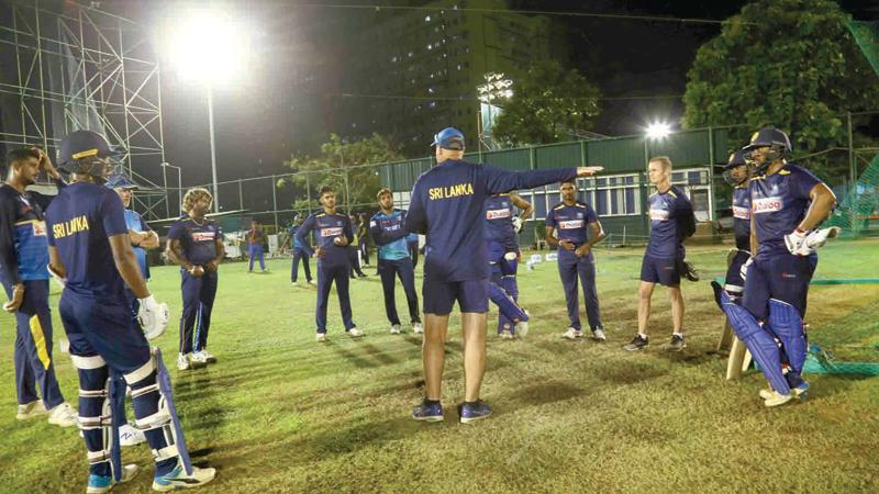 Sri Lanka's cricketers listen to their coach Mickey Arthur at a field team meeting ahead of today's first T20 International in Guwahati, India
