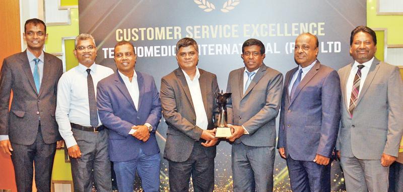Technomedics officials receive the award
