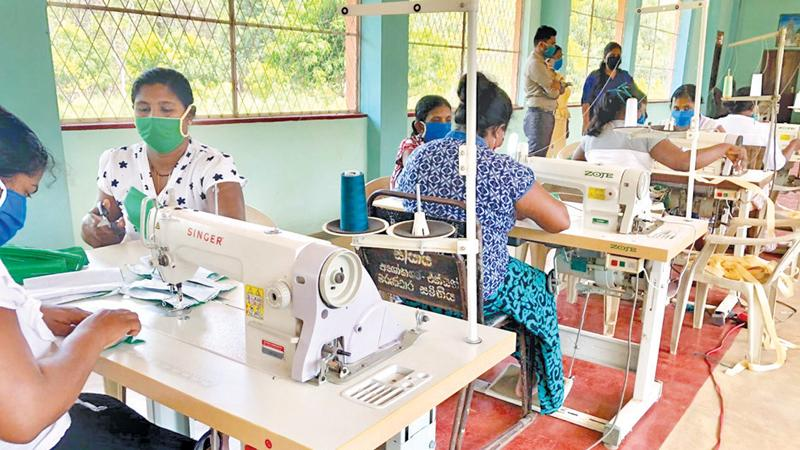 Women sewing face masks