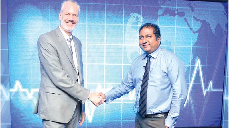 Managing Director and CEO, A. Baur & Co., Rolf Blaser (left) greets Country Manager, Sanofi Lanka, Mario Alphael.