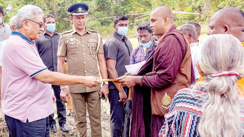 A bhikkhu presents a document to President Gotabaya Rajapaksa