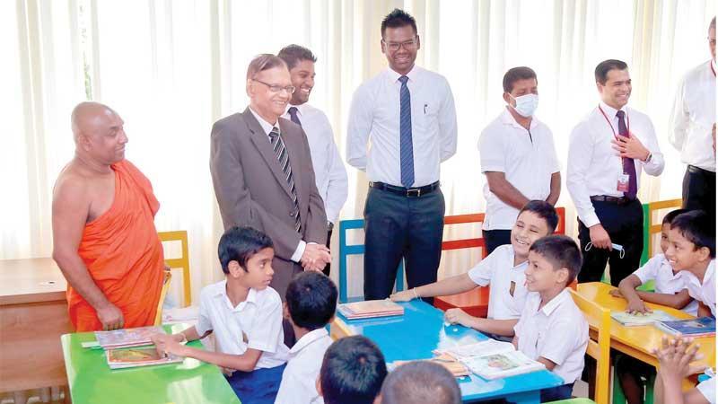 Education Minister G.L. Peiris has a word with the students of Samayawardena Vidyalaya.