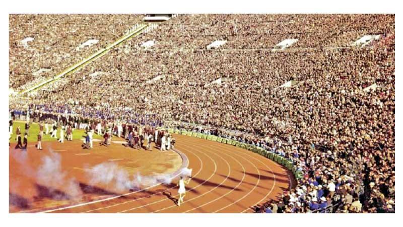 Yoshinori Sakai running with the Flame to the Olympic Cauldron