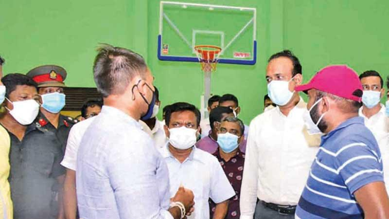 Sports Minister Namal Rajapaksa inspecting the Dadalla Sports Complex which is to have a new Volleyball House very soon while having a discussing with Plantations Minister Ramesh Pathirana and Volleyball president the Deputy Speaker Ranjith Siyambalapitiya