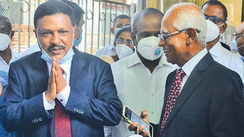 Former Secretary to the President Lalith Weeratunga (on right) and former Telecommunications Regulatory Commission (TRC) Director General Anusha Palpita after being cleared of all charges by court. Pic: Ranjith Asanka