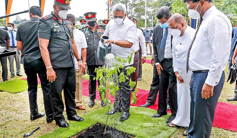 President Gotabaya Rajapaksa planting a white sandalwood sapling near the entrance to the Defence Headquarters