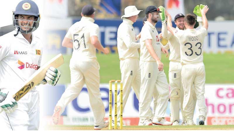 Ramesh Mendis walks back to the pavilion-Mark Wood celebrates the wicket of Ramesh Mendis