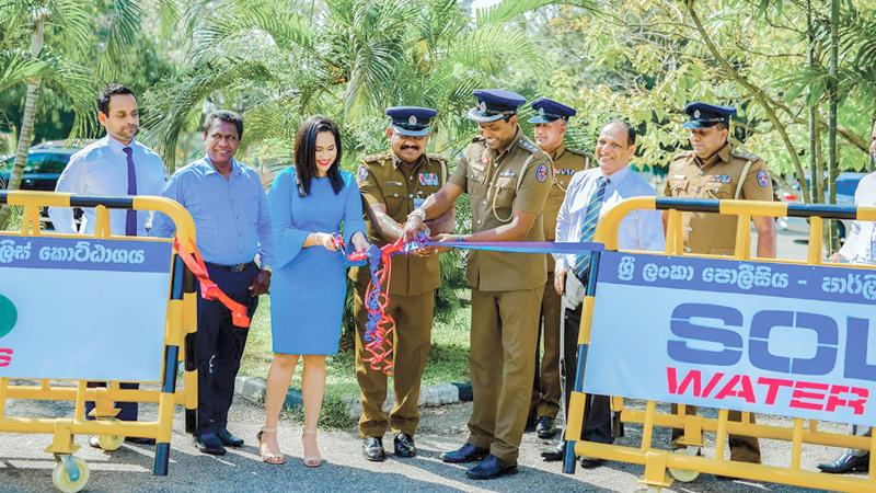 The presentation at the Parliament premises. Director of Branding and Mass Media of the Solex Group, Dr. Sandini Wijayasiri with SSP Parliament Police, Sarath Kumara, SSP Mirihana Police,  Nuwan Asanka and OIC Thalangama Police, Nalinda Dilruk.