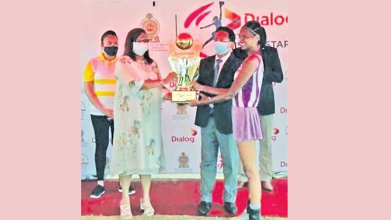 Amali Nanayakkara, Group Chief Marketing Officer, Dialog Axiata PLC and Anuradha Wijekoon, Secretary – Ministry of Youth and Sports, presenting the champions trophy to Chamudi Dilrukshi Wickramaratne, captain of the winning Western Province team