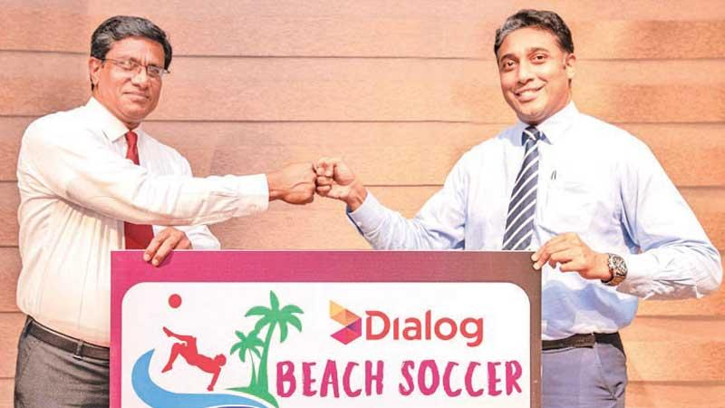 Anura de Silva, president, FFSL (L) and Harsha Samaranayake, Senior General Manager – Brand and Media, Group Marketing of Dialog at presentation of the logo of the Dialog Beach Soccer Championship 2021