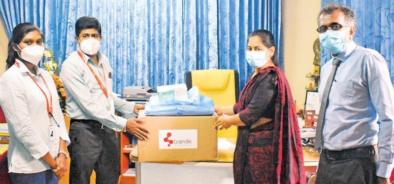 Brandix team members handing over PPE to Dr. (Ms.) V. W. Mihiri  Priyangani – Director of the Kegalle Teaching Hospital