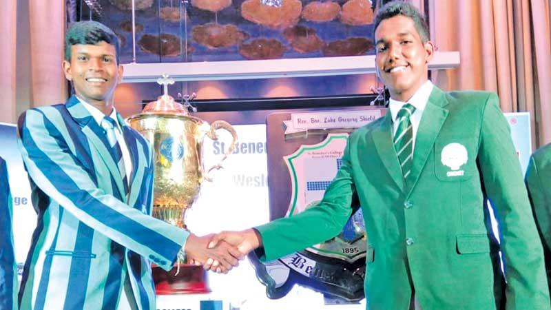 St. Benedict's College captain Kaviru Perera (right) and Wesley College skipper Thenuka Perera shake hands ahead of the Cup and Shield they will play for
