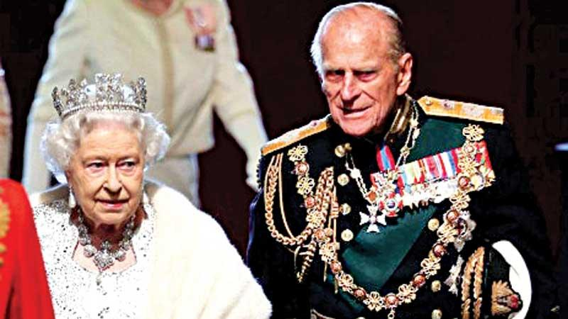 Queen Elizabeth II and Prince Philip at the Palace of Westminster after the state opening of Parliament on May 8, 2013 in London.
