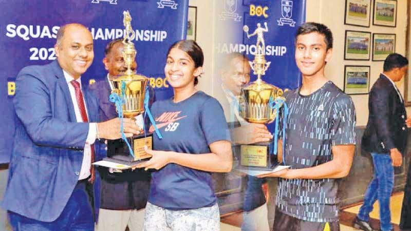 Yehani Kuruppu and Ilham Osmone receiving the champions trophy from the chief guest Rajith Thushantha