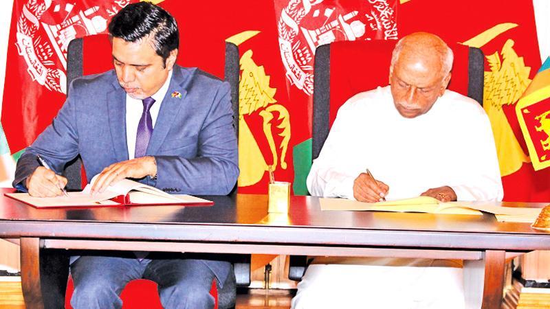 Foreign Minister Dinesh Gunawardena and Afghanistan Ambassador to Sri Lanka, Ashraf Haidari sign the MoU