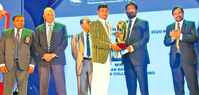 Pawan Ratnayake of Mahanama College receiving the Division One Schoolboy Cricketer award from Minister of Information and Media Keheliya Rambukwella