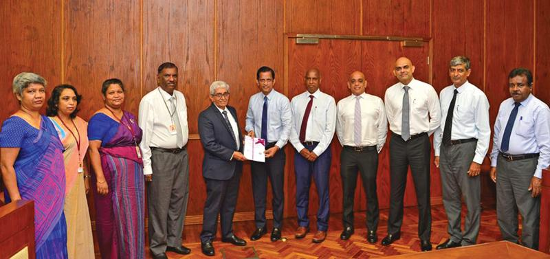 """The presentation of the """"Code of Conduct of Licensed Finance Companies Sri Lanka"""" by FHA Council members to Central Bank Governor Prof. W D Lakshman. Looking on are Deputy Governor Mrs. T. M. J. Y. P. Fernando, Assistant Governor J. P. R. Karunaratne, Addl. Director, Dept. SNBFI Mrs. R. M. C. H. K. Jayasinghe and Additional Director, Dept. of SNBFI Mrs. A. P Liyanapatabendi."""