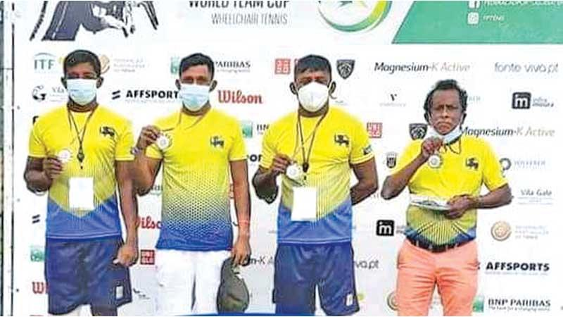 Sri Lanka wheelchair tennis team of Gamini Dissanayake, Suresh Ranaweera and Dharmasena with coach Jagath Welikala