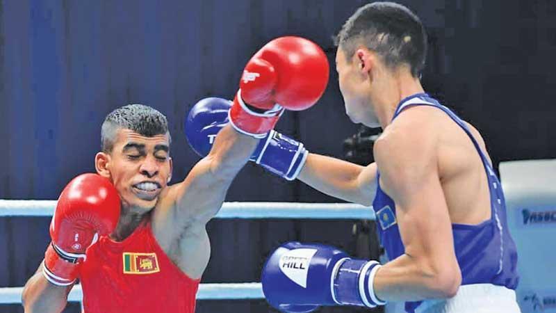 Kazakhstan's Saken Bibossynov parries a left jab from Lasindu Eranda