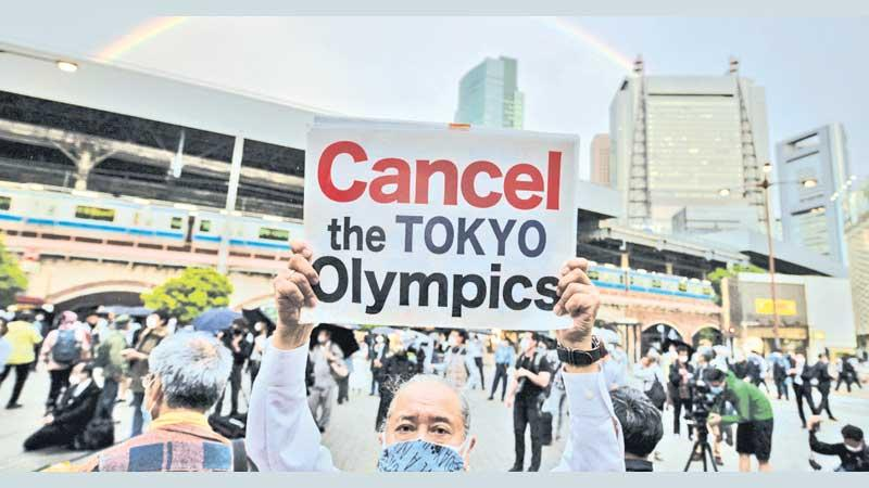A protester calls for the scrapping of the Games