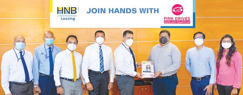 (From left): HNB Leasing Executive, Business Development, Mahesh Ratnayake, HNB, Assistant Manager, Leasing, Roshan De Silva, HNB Head of Leasing, Niluka Amarasinghe, HNB Head of Personal Financial Services, Kanchana Karunagama, HNB Deputy General Manager, Retail and SME Banking, Sanjay Wijemanne, Pink Drives, Founder CEO, Shohan Kulasuriya, Pink Drives COO, Liswith Obinamuni and Pink Drives, Head of Operations, Shani Madurangi at the ceremony.