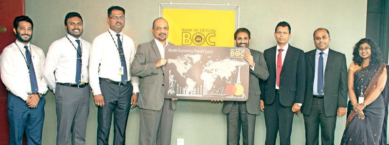 The Bank of Ceylon's Chairman Kanchana Ratwatte and the General Manager D.P.K. Gunasekera (Middle) officially launching the newly upgraded Multi Currency Travel Card. DGM International Treasury and Investment J.M.N. Jeewantha, AGM A.W.R. Thushantha and other bank officials are also in the picture.