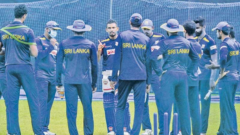 Sri Lanka squad members come together for a meeting with skipper Dasun Shanaka at a practice session