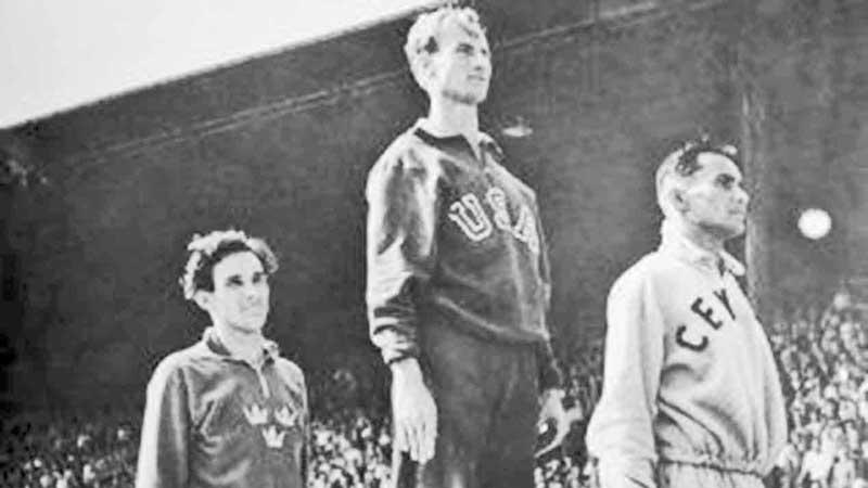 440 yards Hurdles at London  Olympics 1948. From left:  R Larsson (Sweden), Roy Cochran (USA) and Duncan White (Ceylon)