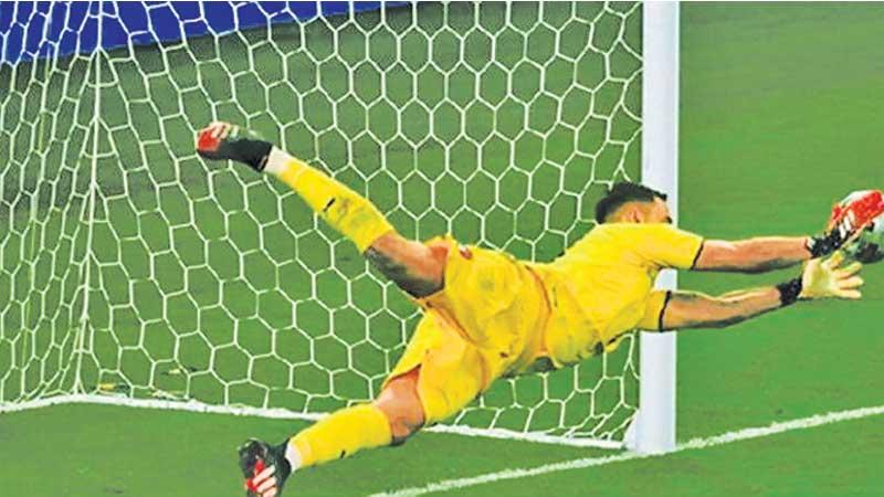 Italy goal keeper Gianluigi Donnarumma makes the most important save of his career to signal victory