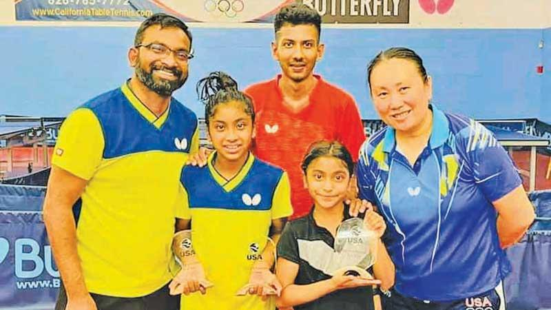 Eight times National TT champion Thilina Piyadasa (left) with his two daughters Tashiya and Tiana and former National champion Udaya Ranasinghe with Olympic silver medalist Gao Jun who is the owner and coach of California TT Club