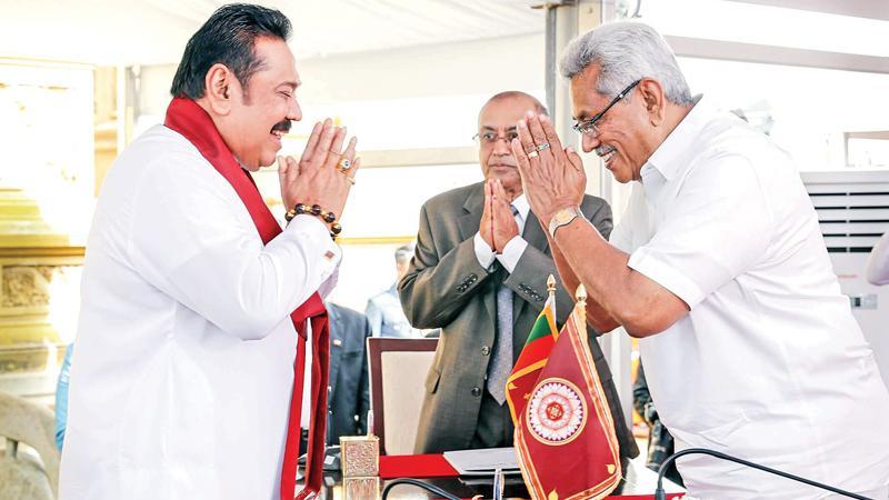 Mahinda Rajapaksa being sworn in as Prime Minister before President Gotabaya Rajapaksa at the Kelani Raja Maha Vihara a year ago