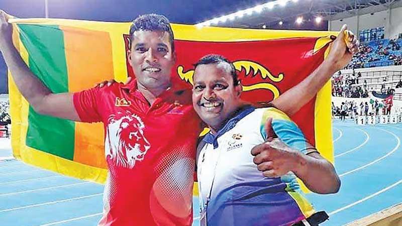 Dinesh Priyantha Herath with his coach Pradeep Nishantha