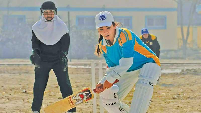 A girl in Afghanistan plays cricket