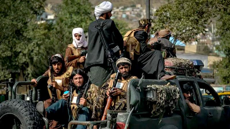 Taliban fighters patrol along a street in Kabul after US troops' withdrew from Afghanistan, (AFP)