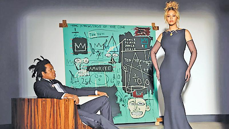 Beyoncé and Jay-Z — and 'Equals Pi' by Jean-Michel Basquiat — in the Tiffany & Company fall 2021 campaign, titled 'About Love.' Credit: Mason Poole