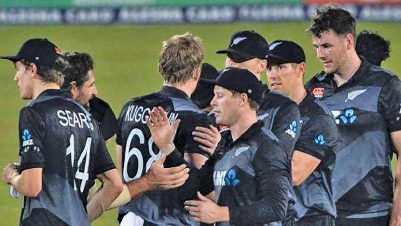 Members of the New Zealand team come together