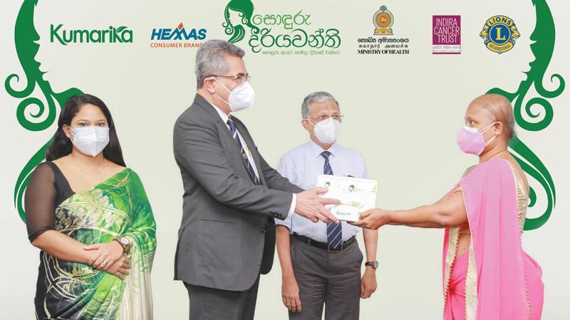 Secretary Ministry of Health, Dr. Sanjeewa Munasinghe presents the first Kumarika Care Pack to Ms. Sudeshika Sandamali. Looking on are Marketing Manager, Hemas Consumer Brands, Ms Azmara Mannan Perera and Director General, Ministry of Health, Dr. Asela Gunawardane.